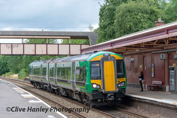 A service train from Birmingham arrives at Henley in Arden to collect 1 passenger.