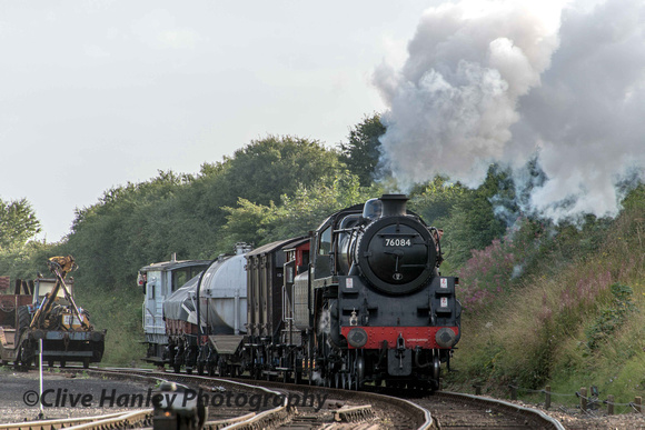 Newly restored Riddles Standard Class 4 loco no 76084 approaches Weybourne with the early freight.