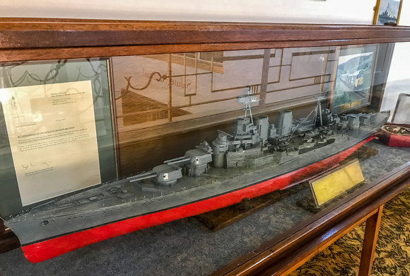 A scale model of HMS Hood, a Letter of tribute from the MOD and ....... at the far end....