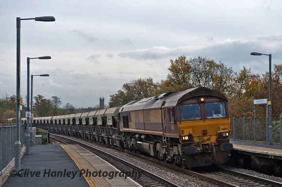 Class 66 no 66012 rumbles through Warwick Parkway with a northbound Lafarge freight.