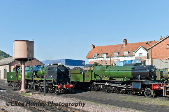 "Preparations for the gala. 34046 Braunton and 7828 Odney Manor (running as ""Norton Manor 40 Commando"") stand at Minehead shed."