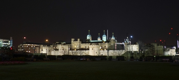 The Tower of London with Tower Bridge visible in the background.